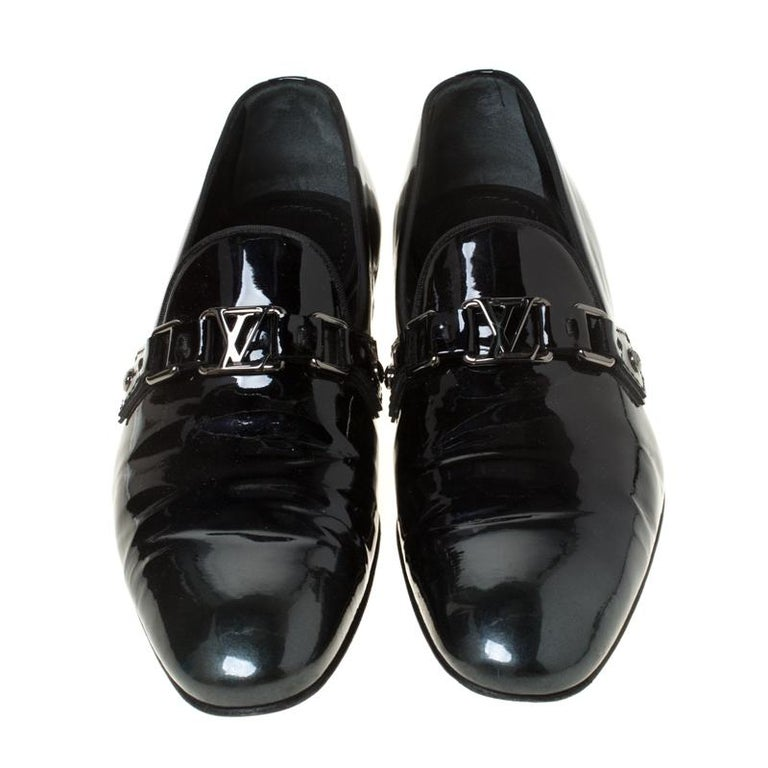 Crafted from patent leather and styled into a luxe shape, this pair of loafers by Louis Vuitton brings a blend of luxury and comfort. They feature the signature LV on the uppers in silver-tone and leather-lined insoles. The loafers will enhance all