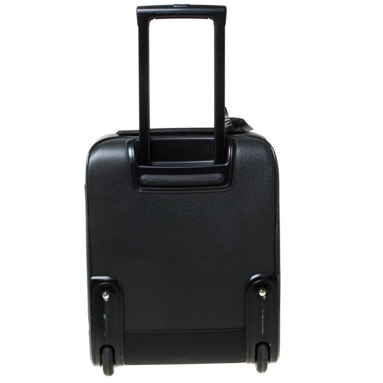 The Pégase 45 by Louis Vuitton is a classic travel bag. Crafted from durable ardoise taiga leather, this compact luggage bag features two-level telescopic handle and interior zipper pockets. With optimised storage space, this two-wheeled bag will