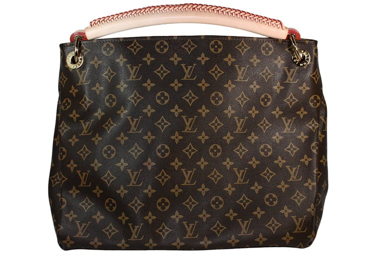 Louis Vuitton shoulder bag Made in France  Classic monogram pattern  Gold hardware Braided leather handle  Soft beige suede lining  Zippered interior pocket and card slots  Comes with yellow dustbag