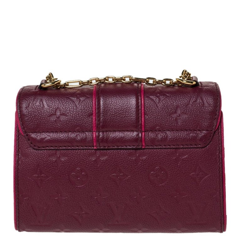 This Louis Vuitton Saint Sulpice bag carries oodles of style and sophistication. Crafted in France, it is made of Monogram Empreinte leather. It comes in a lovely shade of burgundy. It has a flap top with a gold-tone push-lock closure that