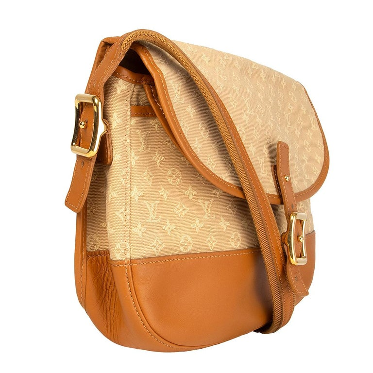 100% authentic Louis Vuitton 'Majorie Shoulder Bag Monogram Mini Lin' in beige Monogram Mini Lin canvas and tan calfskin featuring gold-tone hardware. Opens with a flap and has a another flap pocket under the main flap. Lined in beige canvas with