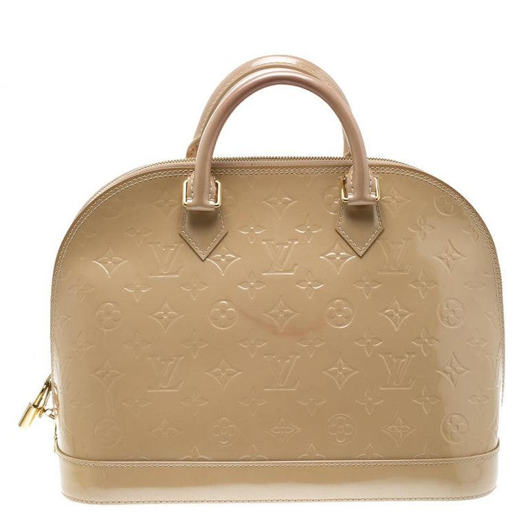 A classic from the house of Louis Vuitton, the shape of the Alma stands out. Louis Vuitton Alma was named after the Alma Bridge that connects Paris's fashionable neighborhood. The bag is made from the signature Monogram Vernis that was introduced in