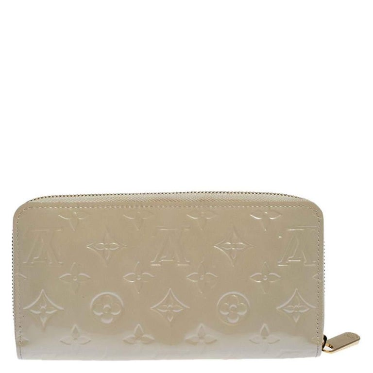 This Louis Vuitton Zippy wallet is conveniently designed for everyday use. Crafted from Monogram Vernis leather, the wallet has a zip closure which opens to reveal multiple slots, leather-fabric compartments and a zip pocket for you to neatly