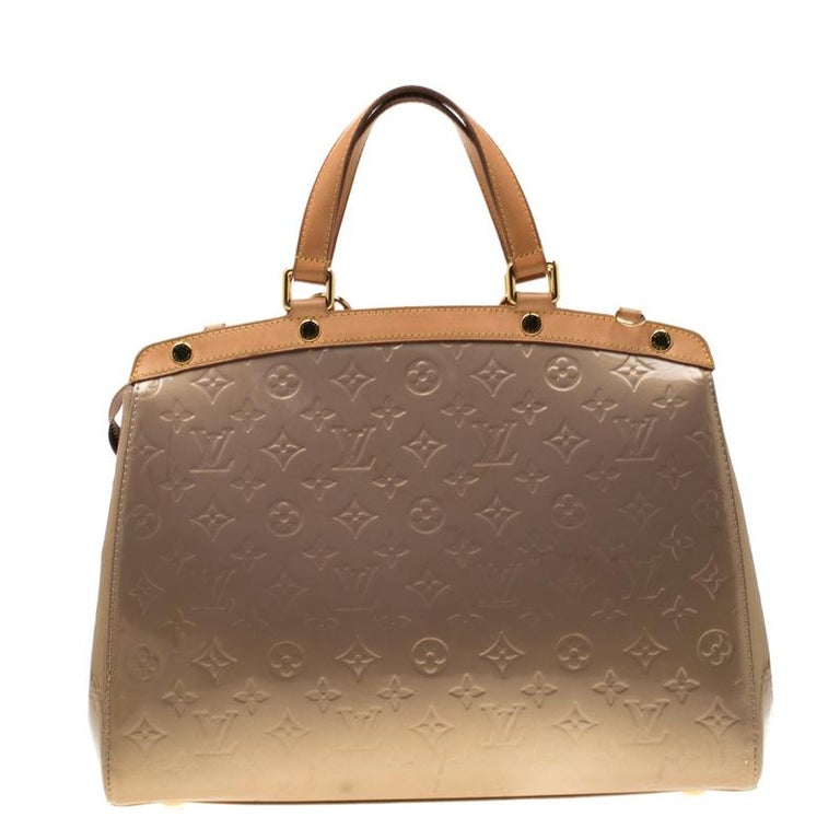 Louis Vuitton Brea's feminine shape is inspired by the doctor's bag. Crafted from signature Monogram Vernis, the bag has a perfect finish. The fabric lined interior is spacious and it is secured by a zipper. The bag features double handles,
