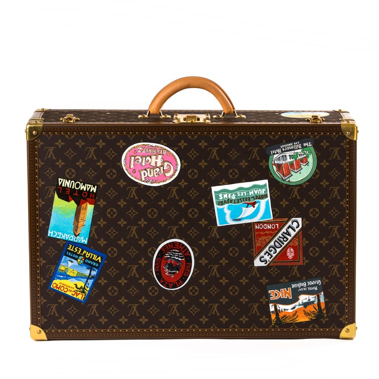 Louis Vuitton Bisten suitcase   Exclusively painted for Palmer & Penn in Beverley Hills. This is a one off item. Beautifully decorated with travel stickers showcasing leading hotels in the world.