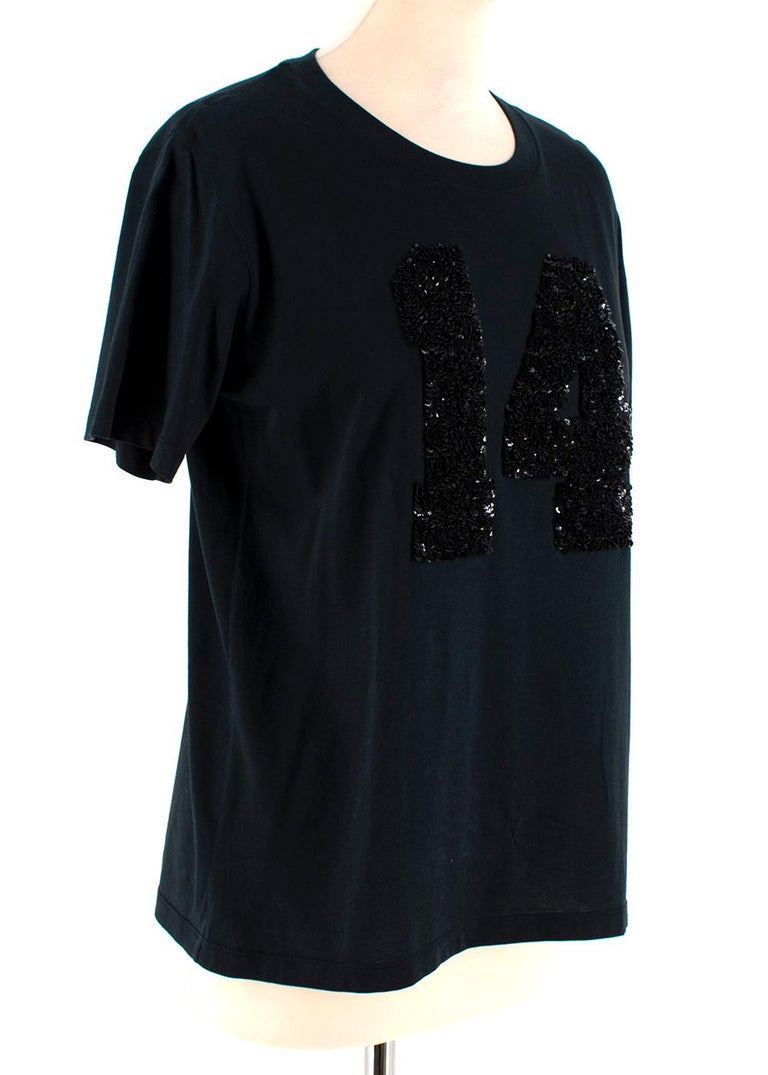 Louis Vuitton Black Cotton 'Paris' 14 Sequin Embellished T-shirt  - Sequin Embellishment to front and back  - Rounded Neckline  - Straight Hemline - Short-Sleeved  Materials  100% Cotton   Dry Clean Only   Made in Italy   Shoulders: 10cm Sleeves: