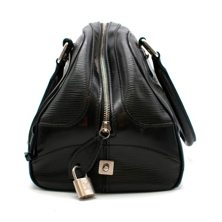 Louis Vuitton Black Epi Leather Bowling Montaigne Bag   - Double leather handles - Durable black epi leather  - Logo embossed in corner  - Silver-toned hardware - Spacious canvas interior with 2 compartments    Material: Epi leather, canvas    Made