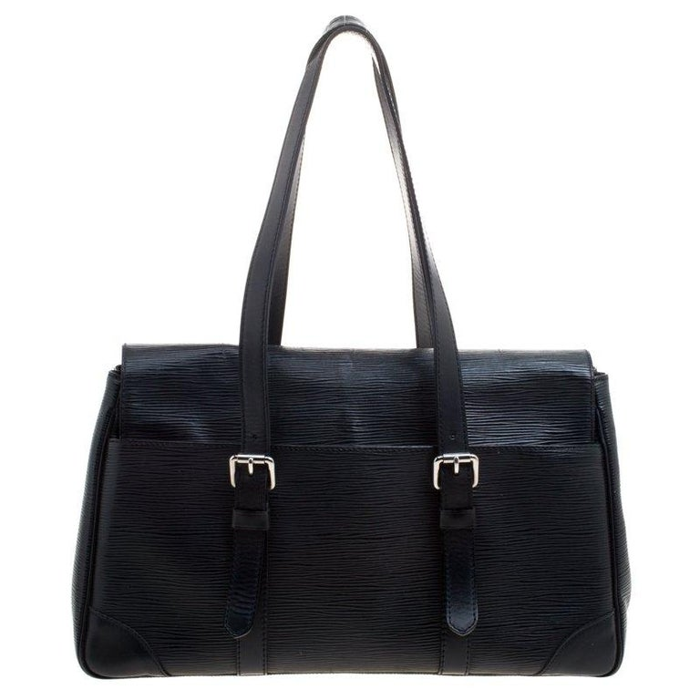 Louis Vuitton's handbags are popular owing to their high style and functionality. This Segur MM bag, like all the other handbags, is durable and stylish. Crafted from black epi leather, the bag can be paraded using the two top handles. It is