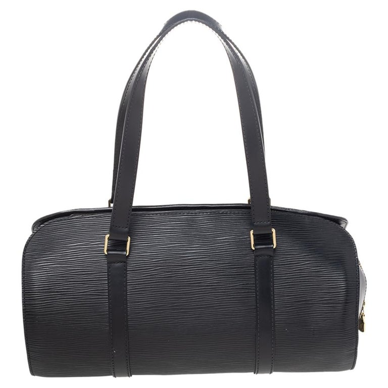 Easy to carry and chic, this Soufflot satchel by Louis Vuitton. The black epi leather exterior is accented with gold-tone hardware. This satchel features two flat leather handles and a zipper closure. The interior is lined with Alcantara and comes