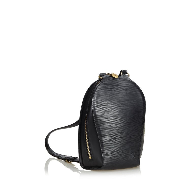 The Mabillon features an epi leather body, flat back straps, metal top handle, zip around closure, exterior zip pocket, and an interior slip pocket. It carries as AB condition rating.  Inclusions:  Dust Bag   Louis Vuitton pieces do not come with an