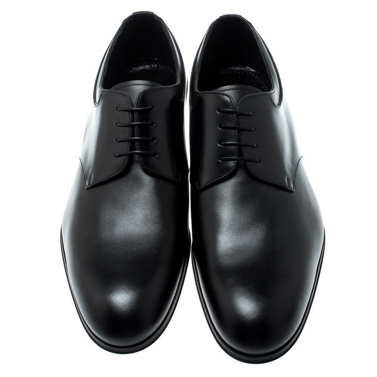 These derbies from Louis Vuitton lend an element of elegance to your overall look. Nothing spells style and panache better than this finely designed black pair. They are crafted from leather and feature neat lace-ups and low heels.  Includes: