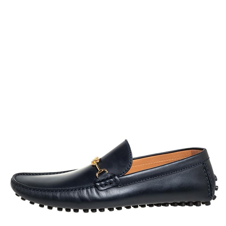 You can always count on these Louis Vuitton LV Club loafers when it comes to a luxe finish. These black loafers are crafted from leather and detailed with the LV accent on the uppers. The shoes are complete with rubber pebbled soles.