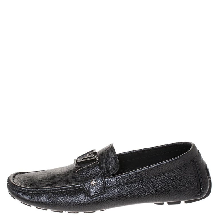 Look sharp and neat with this pair of Monte Carlo loafers from Louis Vuitton. They have been crafted from black leather and designed with the art of fine stitching and the signature LV on the uppers. The pair is complete with comfortable insoles and
