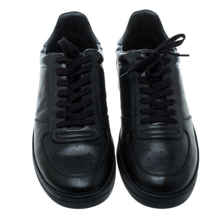 These fabulous sneakers from Louis Vuitton are perfect for the modern man! The black sneakers are crafted from leather and feature round toes, lace-ups on the vamps, comfortable insoles and tough rubber soles. Grab them right away!  Includes: