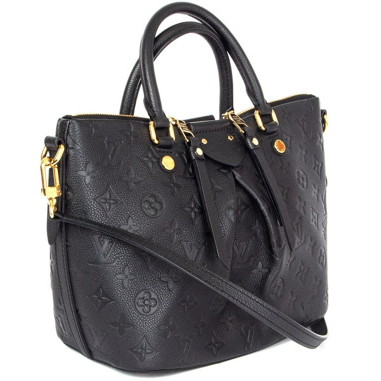 100% authentic Louis Vuitton Monogram Empreinte Leather Mazarine PM shoulder bag form the 2016 Cruise collection. The bag is named for a 17th century Cardinal named Giulio Raimond Mazzarino. Opens with a double zipper on top and is lined in grey