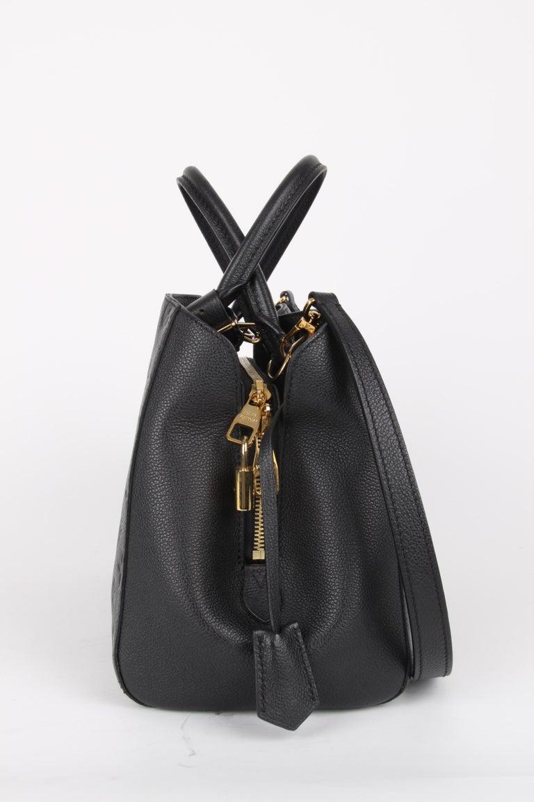 Women's or Men's Louis Vuitton Black Monogram Empreinte Montaigne MM Handbag For Sale