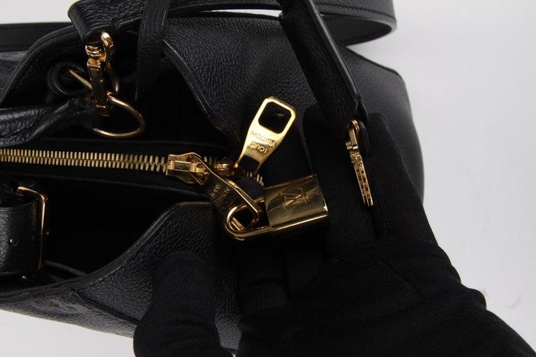 Louis Vuitton Black Monogram Empreinte Montaigne MM Handbag For Sale 1