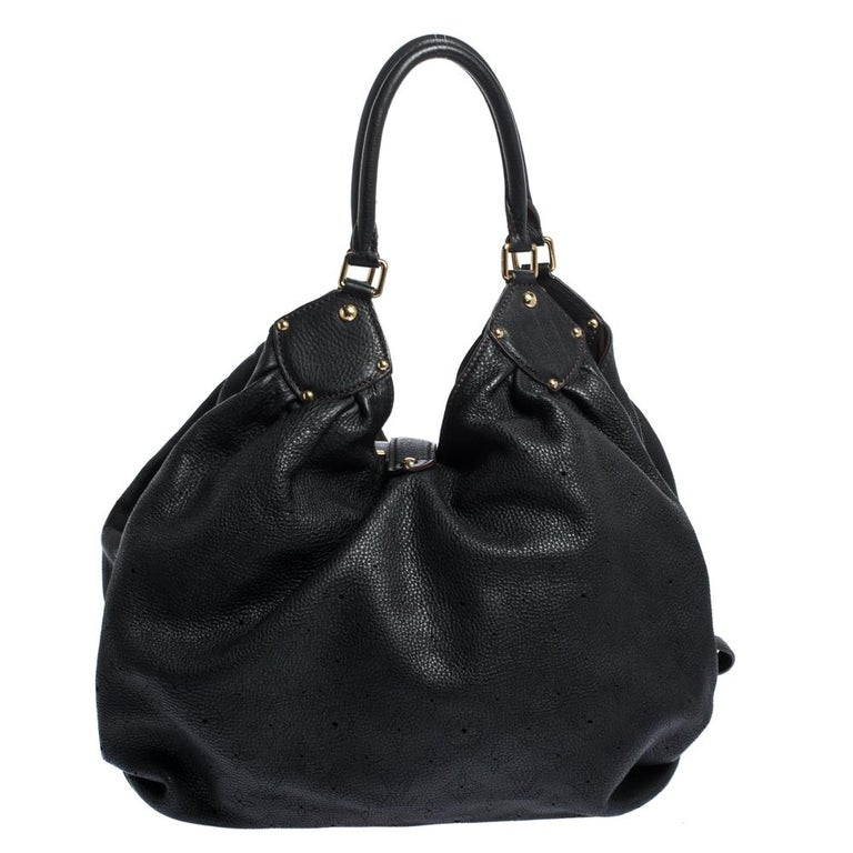 This bag from the house of Louis Vuitton is a delight to own. Featuring a slightly slouchy silhouette made from perforated monogram leather, the bag comes with dual rolled top handles, buckle detailing on the sides, and protective metal feet. The
