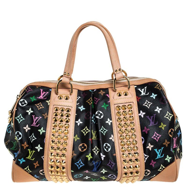 This edgy Courtney bag from Louis Vuitton is named after rock'n'roll star Courtney Love. Sure to stand out, the bag is crafted from iconic multicolore Monogram canvas and is styled with leather trims. The bag comes with dual handles and golden studs