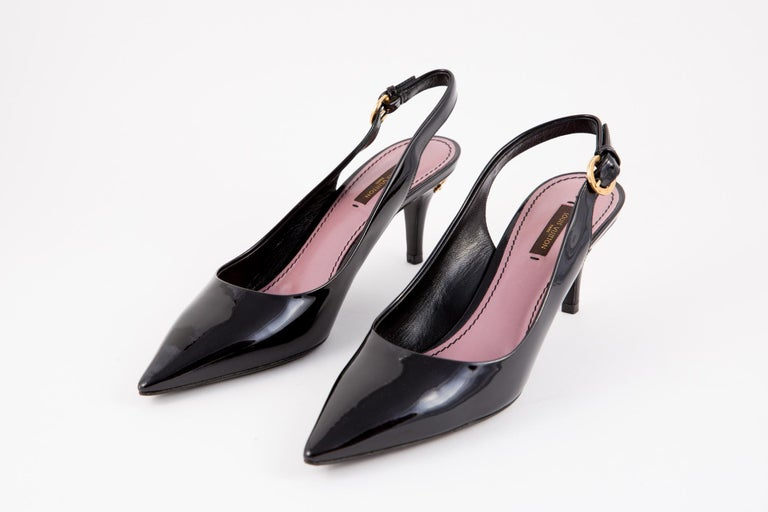 Louis Vuitton black patent leather slingback pumps featuring a pointed toe, a stiletto heel (2.7in (7cm)) and a slingback ankle strap with a side buckle fastening.  In Excellent vintage condition. Delivered in our Dressing Factory Dust Bag. Shoes