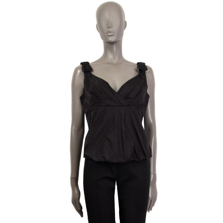 100% authentic Louis Vuitton sleeveless bustier-style top in black silk (100%) embellished with bow detail on shoulders. Opens with a zipper on the back. Has been worn and is in excellent condition.   Measurements Tag Size40 SizeM Bust To84cm