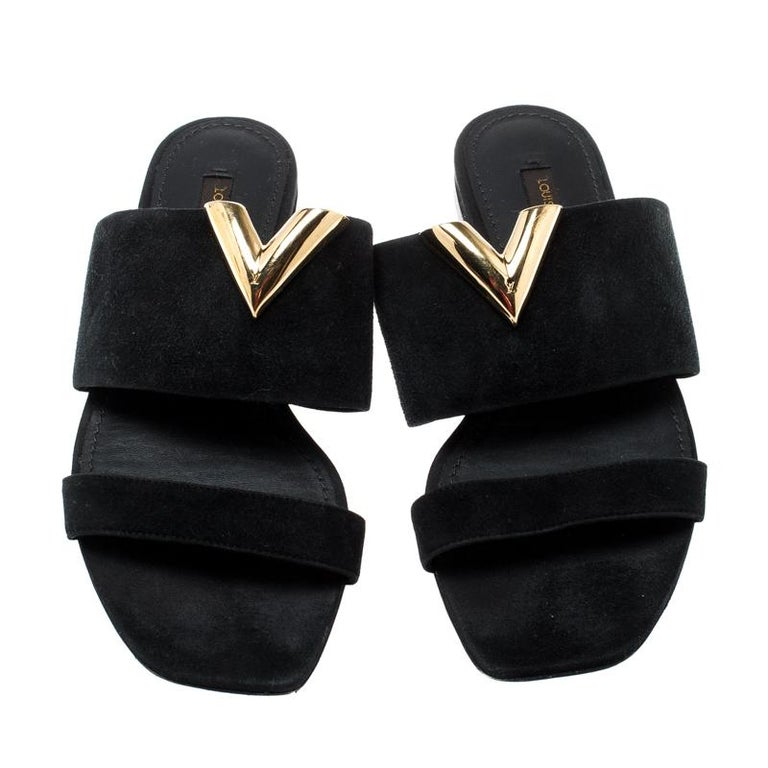 This Louis Vuitton pair is designed in such a way to offer you both comfort and style. These black sandals are designed with two suede straps and detailed with a V motif in gold-tone metal. Lined with leather and high on appeal, this pair is a