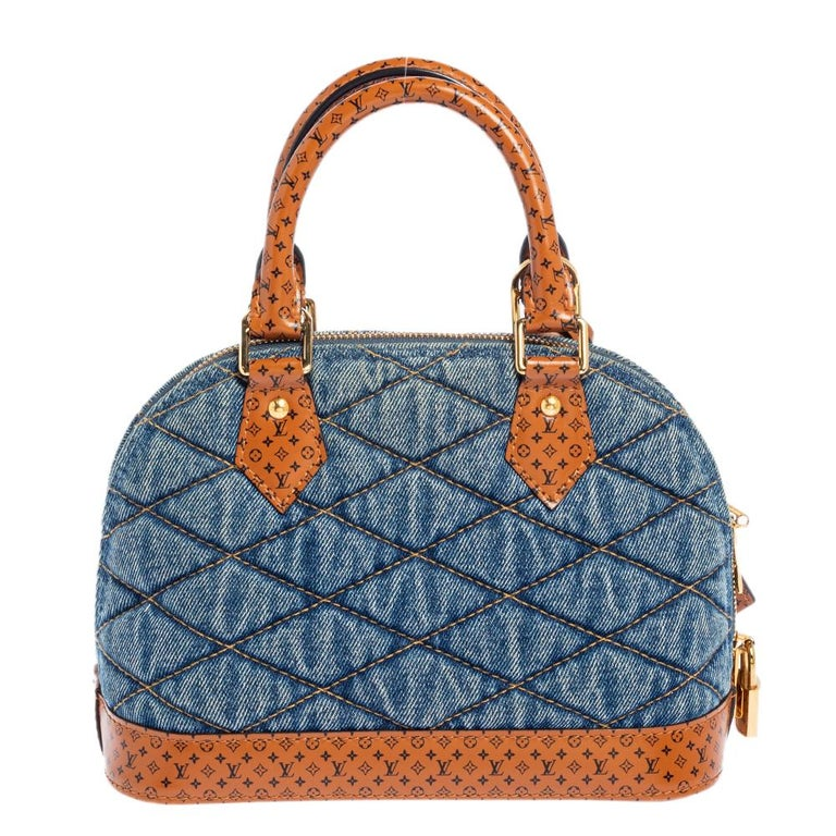 Out of all the irresistible handbags from Louis Vuitton, the Alma is the most structured one. First introduced in 1934 by Gaston-Louis Vuitton, the Alma is a classic that has received love from fashion icons. This piece comes crafted from blue denim