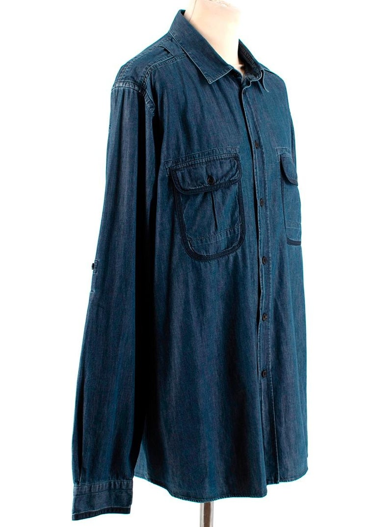 Louis Vuitton Blue Denim Long Sleeve Shirt   -Made of soft cotton denim  -Flap pockets to the front  -Navy trim details to the pockets and cuffs  -Military inspired details to the shoulders  -Graphite branded hardware to the shoulder  -Pleat detail