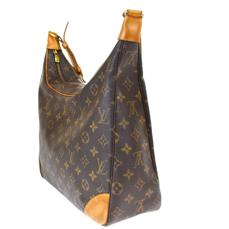 This is an authentic, pre-owned LOUIS VUITTON Boulogne 35 bag.   Its a classic hobo-style handbag for everyday. This , featured in the Monogram canvas with a vachetta leather trim .It has a wide shoulder strap for comfort and support and gold-tone