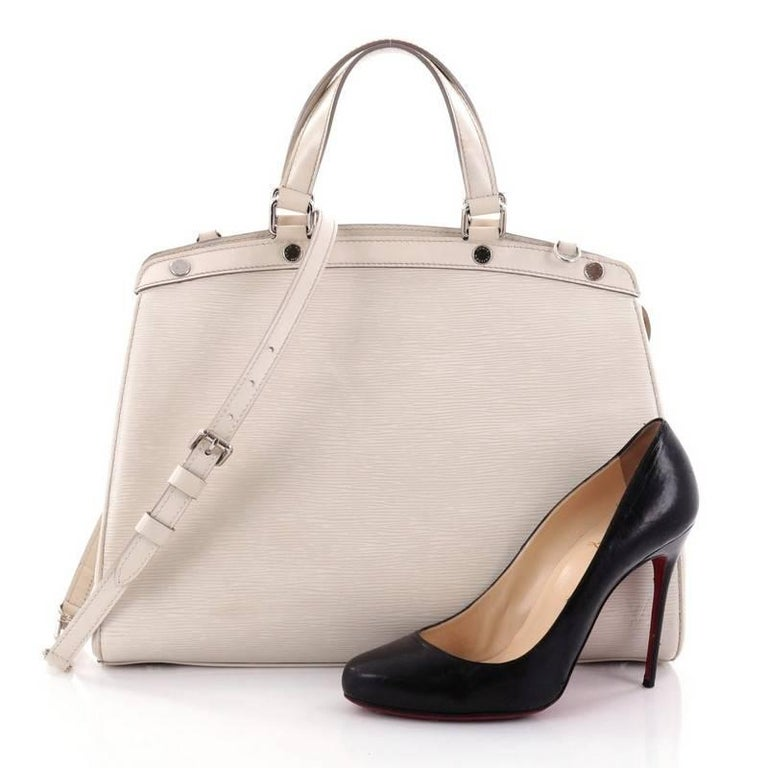 09a3f729f22a This authentic Louis Vuitton Brea Handbag Epi Leather GM is a staple for an  everyday look