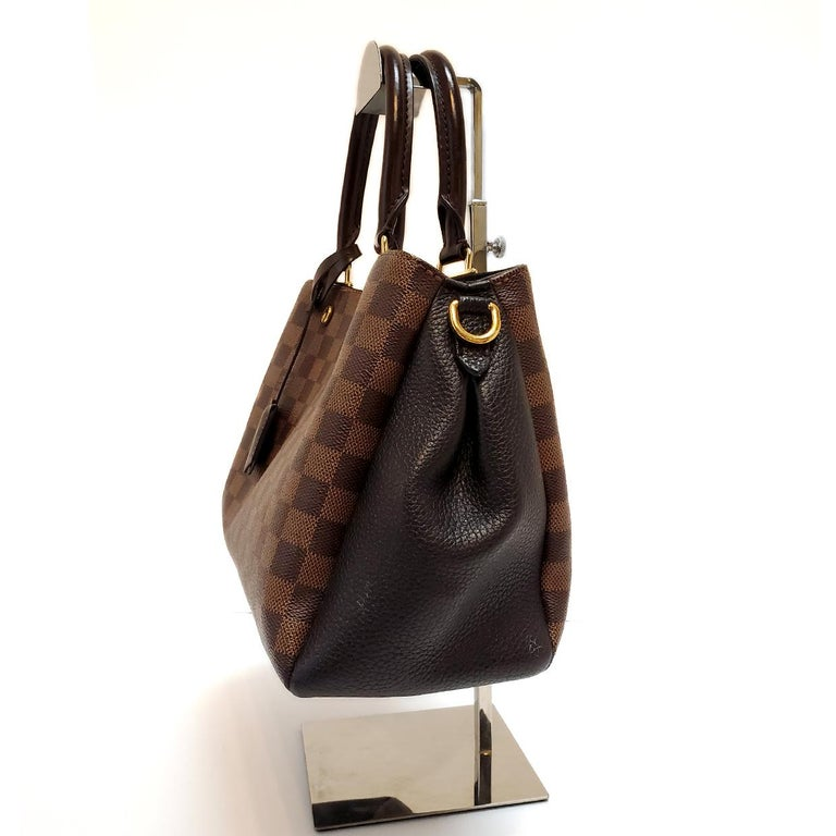 Brand - Louis Vuitton Collection - Brittany Estimated Retail - $2,550.00 Style - Hand Bag Material - Canvas Color - Brown Pattern - Damier Ebene Closure - Snap Hardware Material - Goldtone Model/Date Code - SR2107 Size - Large Feature - Inner