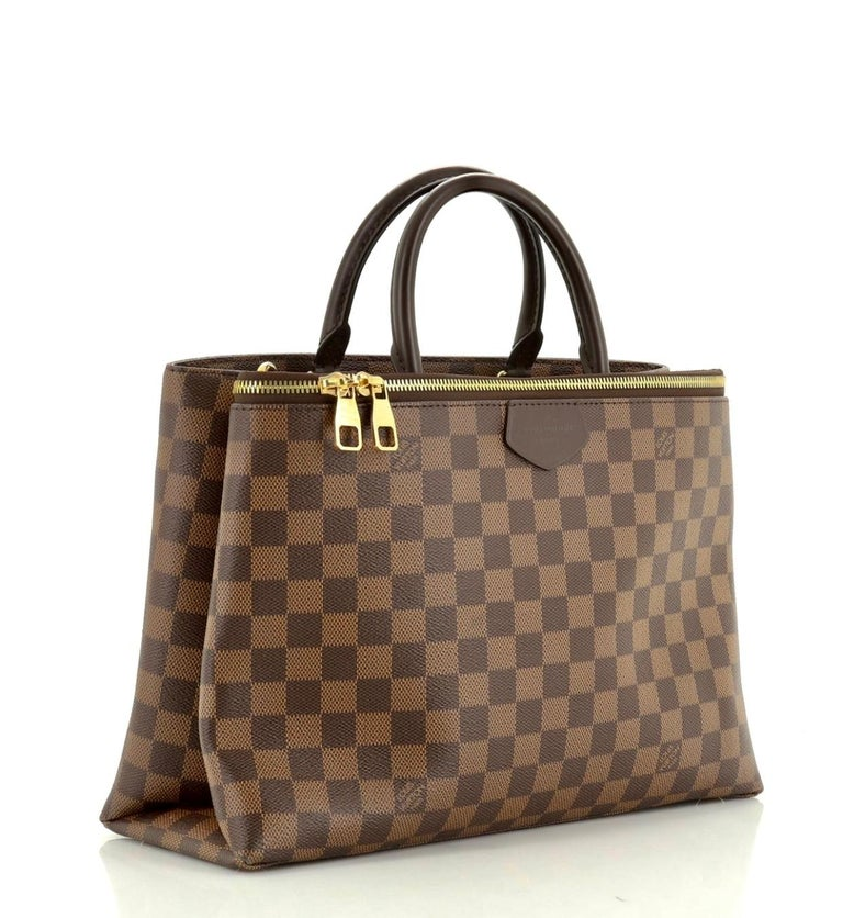 This Louis Vuitton Brompton Handbag Damier, crafted from damier ebene coated canvas, features dual rolled handles, front zip compartment with dual zip closure, and gold-tone hardware. Its hook closure opens to a purple microfiber interior divided
