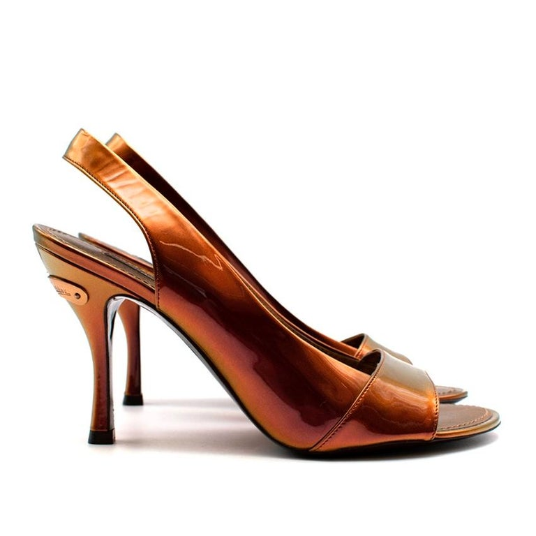 Louis Vuitton Bronze Holographic Sling Back Heeled Sandals  -Classic timeless design  -Gorgeous orange/bronze hue with an holographic effect  -Golden branded hardware to the back  -Elegant sculptural heels  -Luxurious soft leather lining  -Original