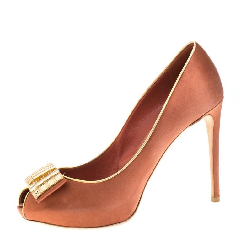 Let your feet essay style as you flaunt these fabulous pumps from Louis Vuitton. These satin shoes will make you look confident and uber-stylish. They feature open toes, embellished details and 11 cm heels to keep you at the top of your style