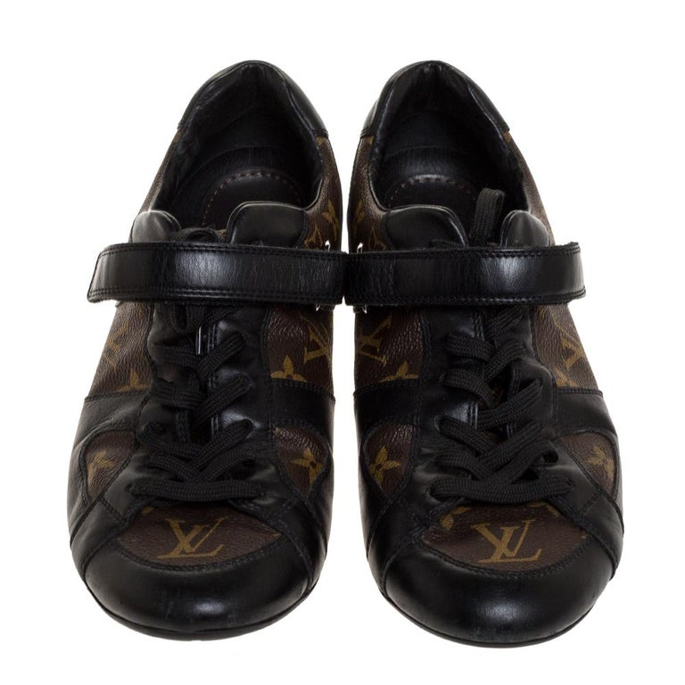 Be prepared to pair these fashionable Globe Trotter sneakers by Louis Vuitton with everything! These lace-up style sneakers with secure Velcro straps have been crafted from durable Monogram canvas and smooth black leather trims accented by the Louis