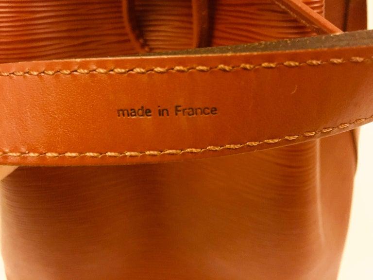 Red Louis Vuitton Brown Epi Bucket Drawstring Bag  For Sale