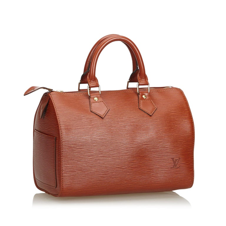 The Speedy 25 features an epi leather body, rolled handles, a top zip closure, and an interior pocket. It carries as B+ condition rating.  Inclusions:  This item does not come with inclusions.   Louis Vuitton pieces do not come with an authenticity