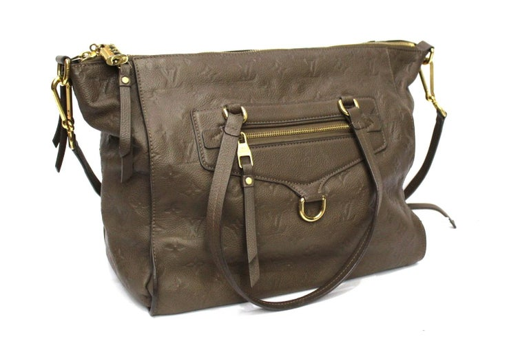 Louis Vuitton bag Ombre model Lumineuse Empreinte line made of brown monogram leather with golden hardware.  Zip closure, very large inside. Equipped with double handle and removable shoulder strap.  Very good condition.