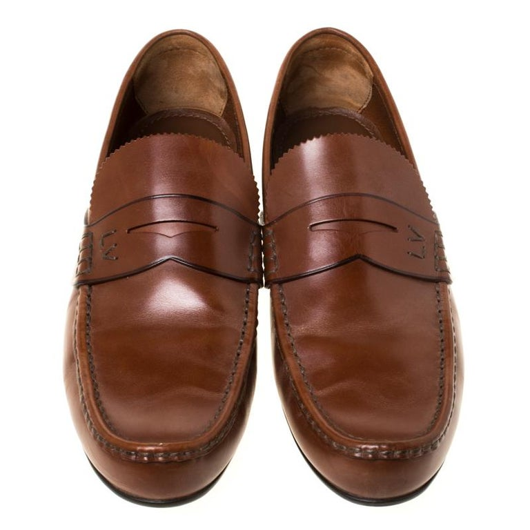 Stylish and super comfortable, this pair of loafers by Louis Vuitton will make a great addition to your shoe collection. They have been crafted from leather and styled with Penny keeper straps on the vamps. Leather insoles and rubber outsoles