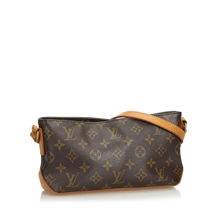The Trotteur features a monogram canvas body, flat vachetta strap, top zip closure, and an interior zip pocket. It carries as B condition rating.  Inclusions:  This item does not come with inclusions.   Louis Vuitton pieces do not come with an