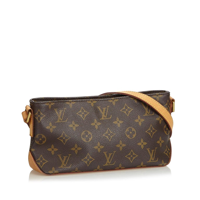 The Trotteur features a monogram canvas body, flat vachetta strap, top zip closure, and an interior zip pocket. It carries as B+ condition rating.  Inclusions:  This item does not come with inclusions.   Louis Vuitton pieces do not come with an