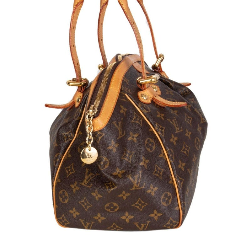 Louis Vuitton 'Tivoli GM' shoulder bag in brown and olive monogram canvas. Opens with a zipper on top and is lined in brown canvas with two open pockets against the back and one open pocket against the front. Has been carried with some natural