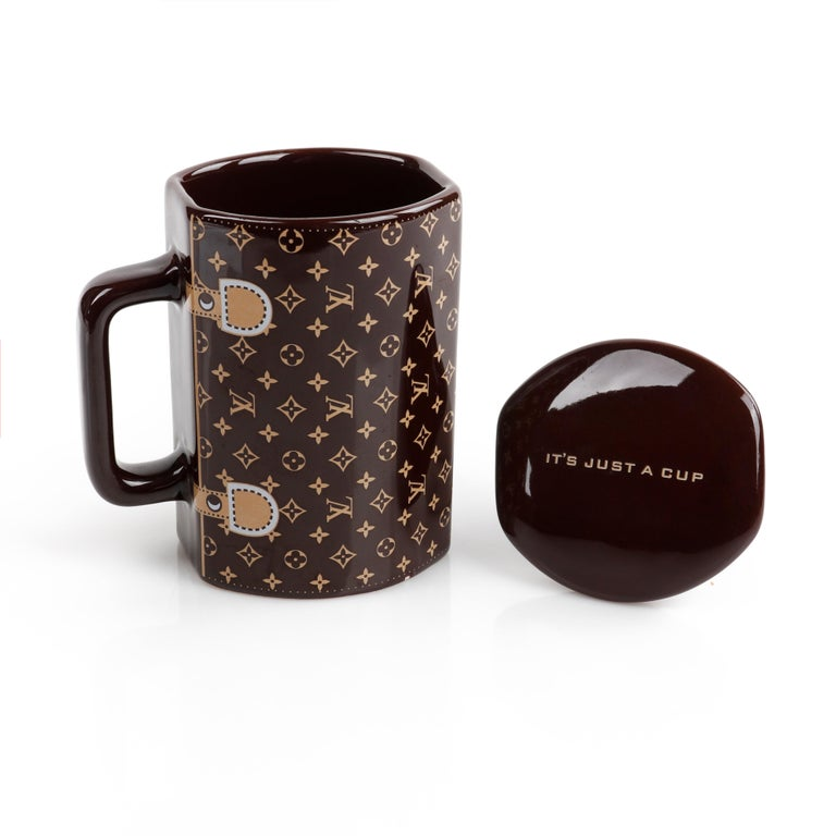 LOUIS VUITTON Brown Monogram Ceramic Coffee Tea Cup Mug RARE   Style: Mug / Cup Color(s): Shades of brown Lined: No     Unmarked Fabric/Hardware Content: Ceramic  Additional Details / Inclusions: Brown monogram; mug shape resembles the shape of a