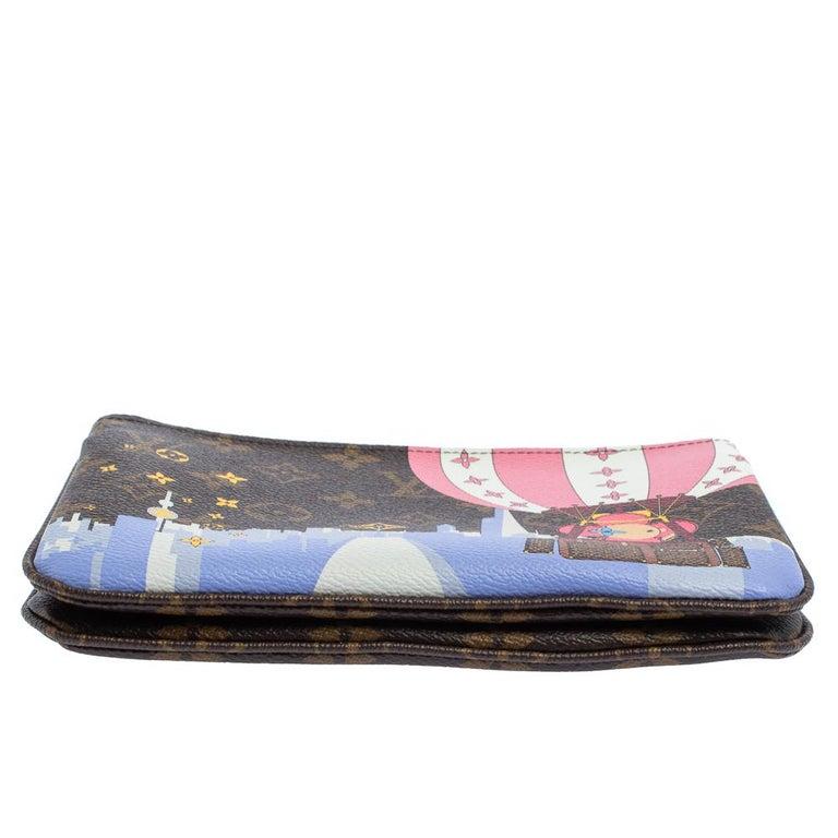 Women's Louis Vuitton Brown Monogram Christmas Edition Double Zip Pochette For Sale