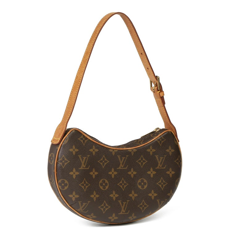 LOUIS VUITTON Brown Monogram Coated Canvas & Vachetta Leather Croissant PM   Xupes Reference: HB3947 Serial Number: SP1022 Age (Circa): 2002 Accompanied By: Louis Vuitton Dust Bag Authenticity Details: Date Stamp (Made in France)  Gender: