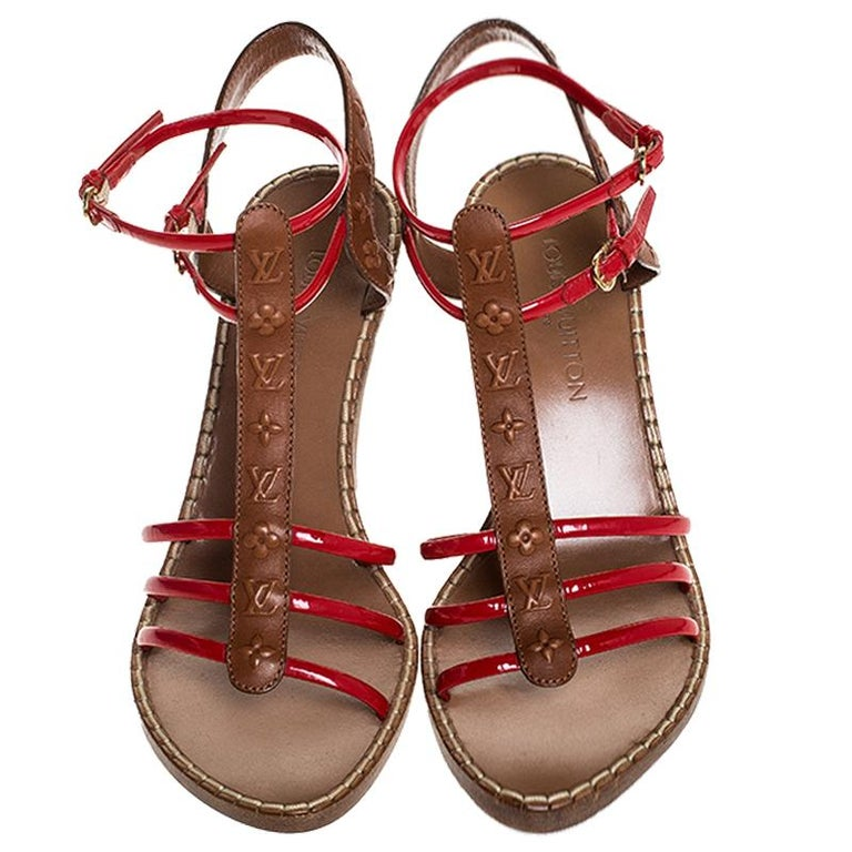 Louis Vuitton Brown Monogram Embossed Leather And Red Wedge Sandals Size 40 In Good Condition For Sale In Dubai, Al Qouz 2