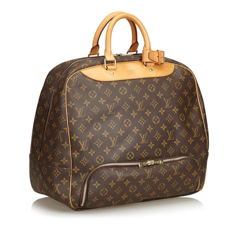 The Evasion features a monogram canvas body, rolled leather handles, an exterior zip pocket, a top zip closure, and an interior slip pocket. It carries as B+ condition rating.  Inclusions:  This item does not come with inclusions.   Louis Vuitton
