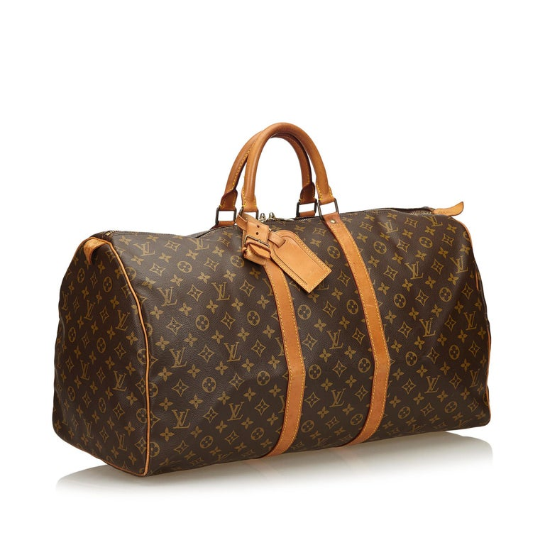 The Keepall 55 features a monogram canvas body, rolled leather handles, a detachable shoulder strap, and a top zip closure. It carries as B+ condition rating.  Inclusions:  This item does not come with inclusions.   Louis Vuitton pieces do not come