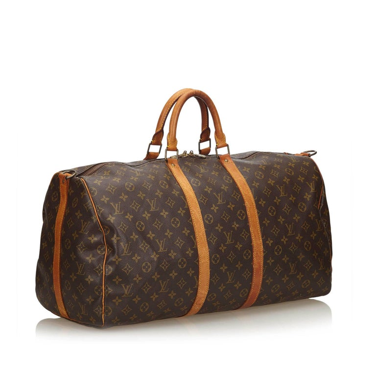 The Keepall Bandouliere 55 features a monogram canvas body, rolled leather handles, and a top zip closure. It carries as B condition rating.  Inclusions:  This item does not come with inclusions.   Louis Vuitton pieces do not come with an