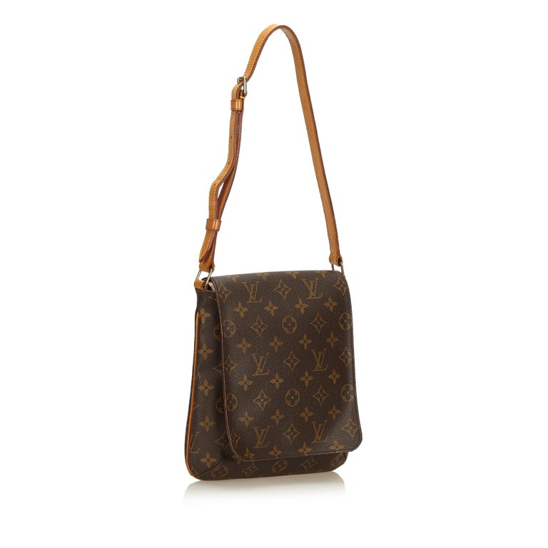 The Musette Salsa features a monogram canvas body, an adjustable shoulder strap with belt details, front flap with a magnetic closure, and an interior slip pocket. It carries as B+ condition rating.  Inclusions:  This item does not come with
